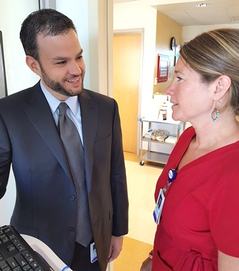 Kyle Staller, MD, consults with Katie Matthews, RN.